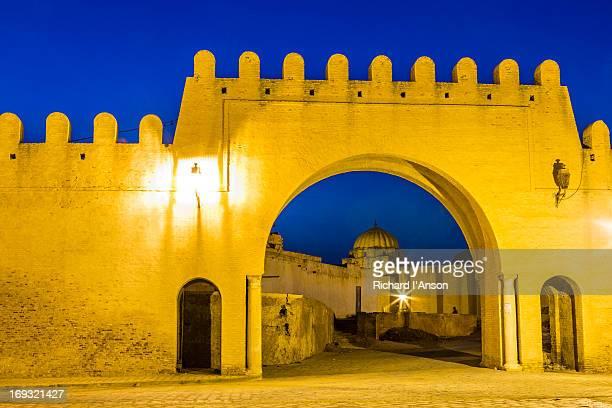 bab el-khoukha gate in medina wall at dusk - kairwan stock pictures, royalty-free photos & images