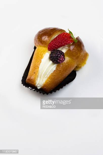 Babˆ with rum cream and blackberry Italy Europe