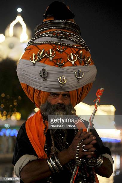 Baba 'Avtar' Singh a member of the traditional Sikh religious warriors' Nihang Army clad in a 300 meterlong turban poses as he pays his respects at...