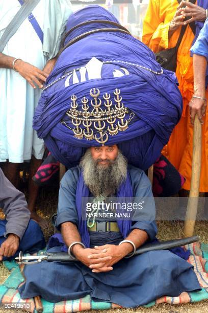 Baba 'Balwant' Singh member of the traditional Sikh religious warriors' Nihang Army wears a 700 m 60 kg turban on 'Fateh Divas' in Amritsar on...