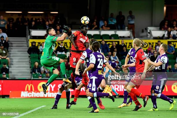 Baba Diawara of Adelaide compete for the ball against Liam Reddy of the Glory during the round 14 ALeague match between the Perth Glory and Adelaide...