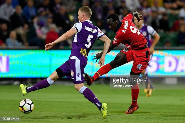 Baba Diawara of Adelaide kicks the ball during the round 14 ALeague match between the Perth Glory and Adelaide United at nib Stadium on January 5...