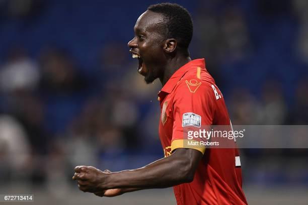 Baba Diawara of Adelaide United celebrates scoring a goal during the AFC Champions League Group H match between Gamba Osaka v Adelaide United at...