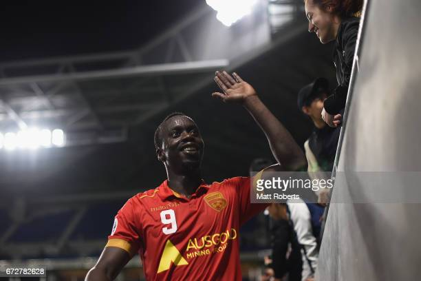 Baba Diawara of Adelaide United celebrates with fans during the AFC Champions League Group H match between Gamba Osaka v Adelaide United at Suita...