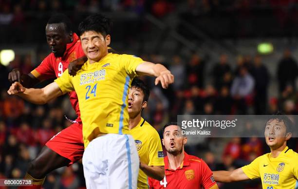 Baba Diawara of United and Ji Xiang of Jiangsu FC competes for the ball during the AFC Champions League match between Adelaide United and Jiangsu...