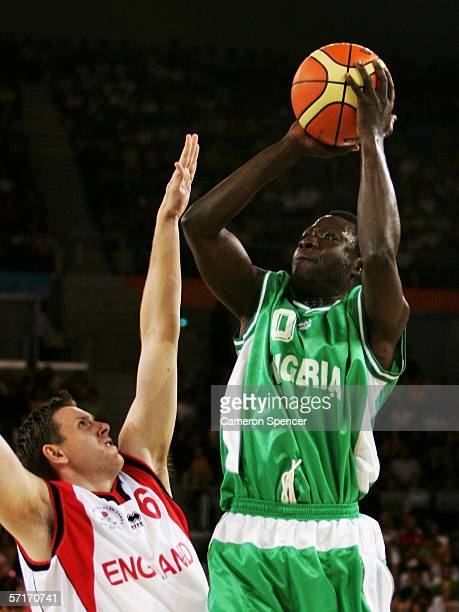 Baba Jubril of Nigeria attempts a shot in the men's bronze medal basketball game between England and Nigeria at the Melbourne Park Multi Purpose...