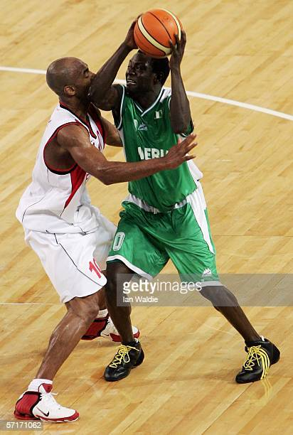 Baba Jubril of Nigeria looks for a pass in the men's bronze medal basketball game between England and Nigeria at the Melbourne Park Multi Purpose...