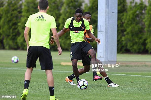 Baba Rahman John Obi Mikel during a Chelsea training session at Chelsea Training Ground on July 12 2016 in Cobham England
