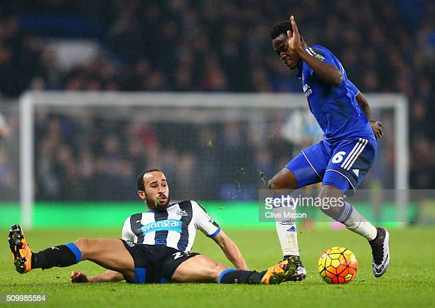 Baba Rahman of Chelsea and Andros Townsend of Newcastle United compete for the ball during the Barclays Premier League match between Chelsea and...