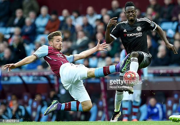 Baba Rahman of Chelsea is tackled by Jordan Lyden of Aston Villa during the Barclays Premier League match between Aston Villa and Chelsea at Villa...