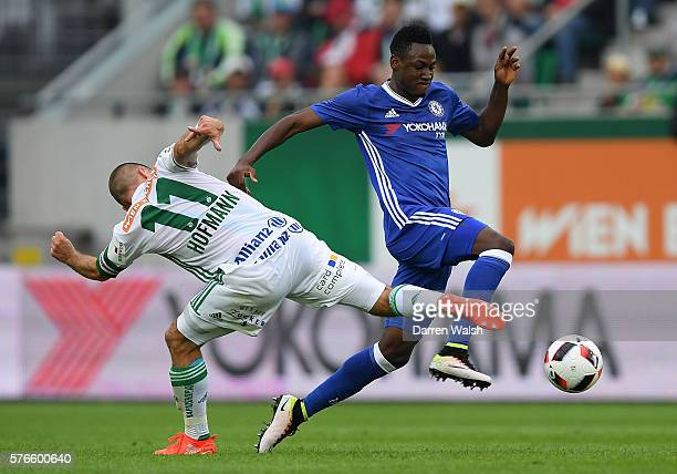 Baba Rahman of Chelsea skips past the tackle of Steffen Hofmann of SK Rapid Vienna during a friendly match between SK Rapid Vienna and Chelsea on...