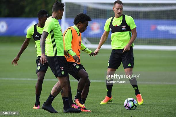 Baba Rahman Willian during a Chelsea training session at Chelsea Training Ground on July 12 2016 in Cobham England