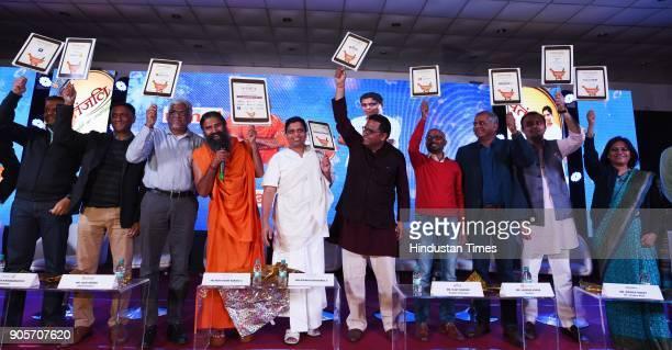 Baba Ramdev and Acharya Balkishan with Hari Menon Pradeep Dadha Saurabh Kumar and Manish Tiwary at the launch of Patanjali eportal Haridwar to Har...
