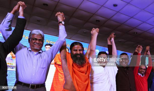 Baba Ramdev and Acharya Balkishan with Hari Menon Pradeep Dadha Saurabh Kumar at the launch of Patanjali eportal Haridwar to Har Dwar on January 16...