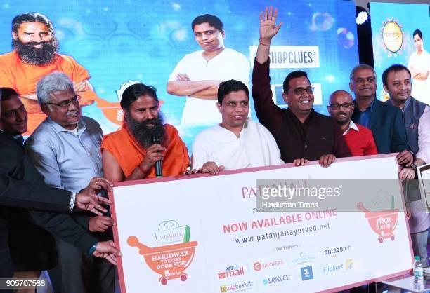 Baba Ramdev and Acharya Balkishan with Hari Menon Pradeep Dadha Saurabh Kumar Founder Grofers Manish Tiwary at the launch of Patanjali eportal...