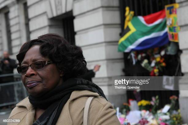 Baba Sithole, a South African nurse who met Nelson Mandela, standing in front of South Africa House in London's Trafalgar Square following news of...