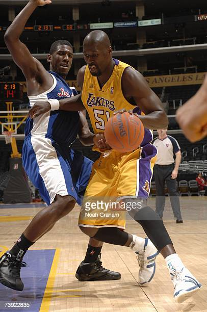 Babacar Camara of the Los Angeles DFenders moves the ball around Steven Smith of the Anaheim Arsenal during the DLeague game on April 1 2007 at...