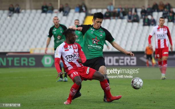 Babacar Dione of Mouscron and Naomichi Ueda of Cercle fight for the ball during the Jupiler Pro League playoff 2 group B match between Cercle Brugge...