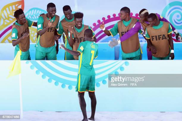 Babacar Fall of Senegal celebrates a goal with team mates during the FIFA Beach Soccer World Cup Bahamas 2017 group A match between Switzerland and...