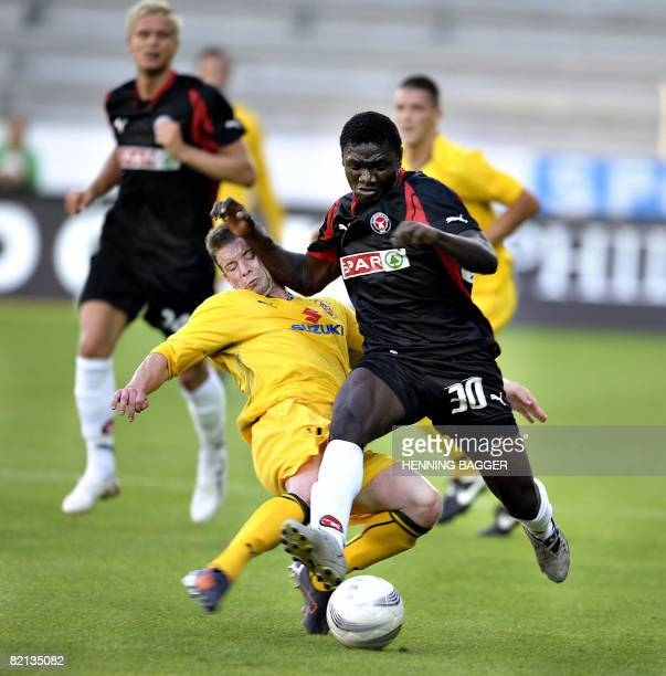Babajide Babatunden of FCM and David Swanick of Bangor City vie for the ball during their first round second leg UEFA Cup qualification soccer match...