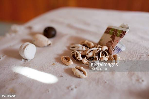 Babalawo reading a fortune with money cowry shells Santeria is a syncretic religion practiced in Cuba it is a mixture of Yoruba tribal practices...