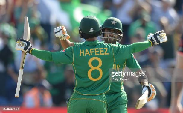 Babar Azam and Mohammad Hafeez of Pakistan embrace after winning the ICC Champions Trophy match between England and Pakistan at Swalec stadium on...