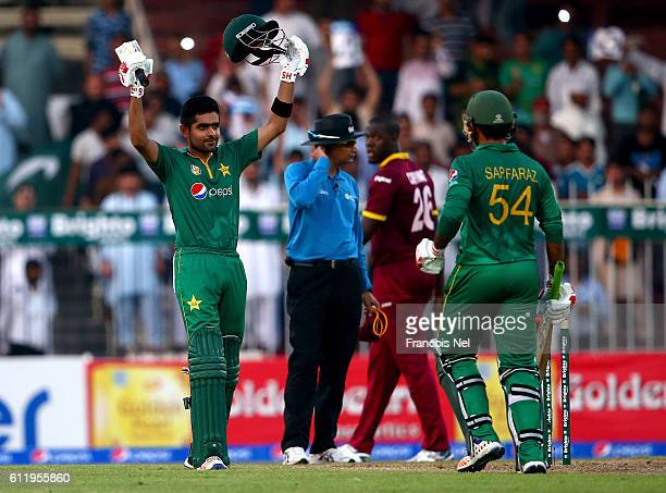 Babar Azam of Pakisatn celebrates after reaching his century during the second One Day International match between Pakistan and West Indies at...
