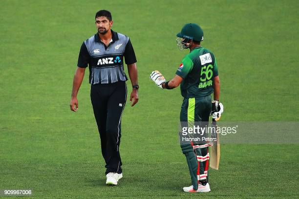 Babar Azam of Pakistan apologises to Ish Sodhi of the Black Caps after hitting him in the hand during the International Twenty20 match between New...