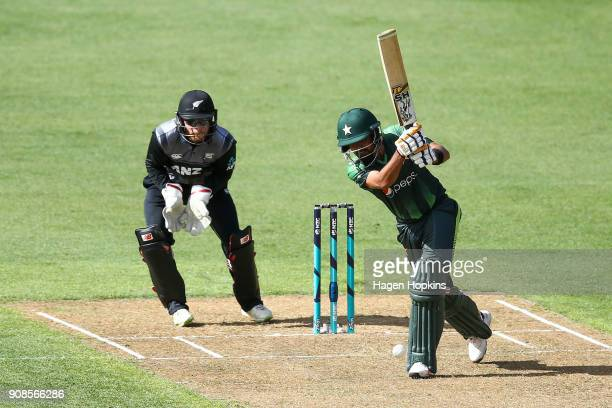 Babar Azam of Pakistan bats while Glenn Phillips of New Zealand looks on during game one of the Twenty20 series between New Zealand and Pakistan at...