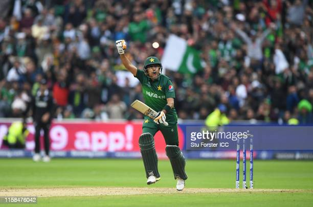 Babar Azam of Pakistan celebrates after scoring a century during the Group Stage match of the ICC Cricket World Cup 2019 between New Zealand and...
