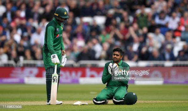 Babar Azam of Pakistan celebrates reaching his century alongside Shoaib Malik of Pakistan during the 4th One Day International between England and...