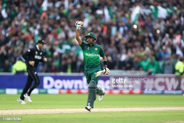 Babar Azam of Pakistan celebrates reaching his century during the Group Stage match of the ICC Cricket World Cup 2019 between New Zealand and...