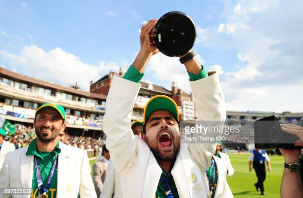 Babar Azam of Pakistan celebrates with the trophy during the ICC Champions Trophy Final match between India and Pakistan at The Kia Oval on June 18...