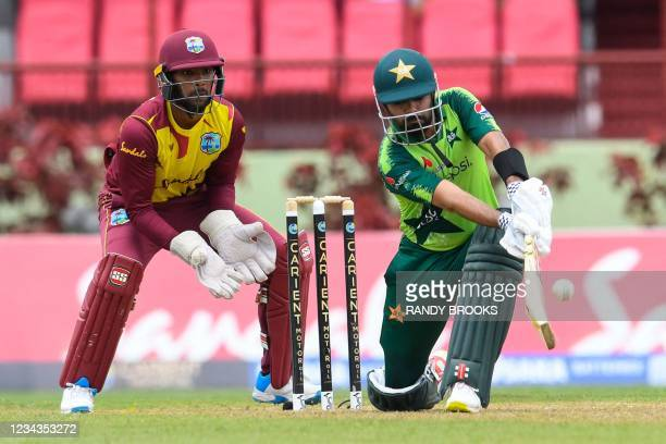 Babar Azam of Pakistan hits 4 as Nicholas Pooran of the West Indies watch during the 2nd T20I match between the West Indies and Pakistan at Guyana...