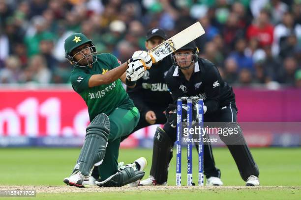 Babar Azam of Pakistan hits to the legside as New Zealand wicketkeeper Tom Latham looks on during the Group Stage match of the ICC Cricket World Cup...