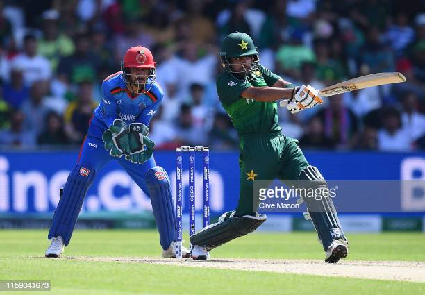 Babar Azam of Pakistan in action batting as Ikram Ali Khil of Afghanistan looks on during the Group Stage match of the ICC Cricket World Cup 2019...