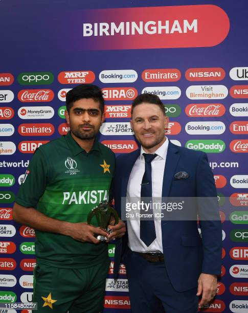 Babar Azam of Pakistan is presented with the Man of the match award by Former New Zealand Cricketer Brendon Mccullum during the Group Stage match of...