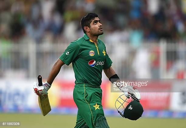 Babar Azam of Pakistan leaves the field after being dismissed by Kieron Pollard of West Indies during the first One Day International match between...