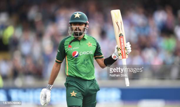 Babar Azam of Pakistan raises his bat after getting out for 158 runs during the 3rd Royal London Series One Day International match between England...