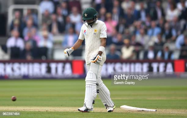 Babar Azam of Pakistan reacts after being hit on the arm by Ben Stokes of England during day two of the 1st NatWest Test match between England and...