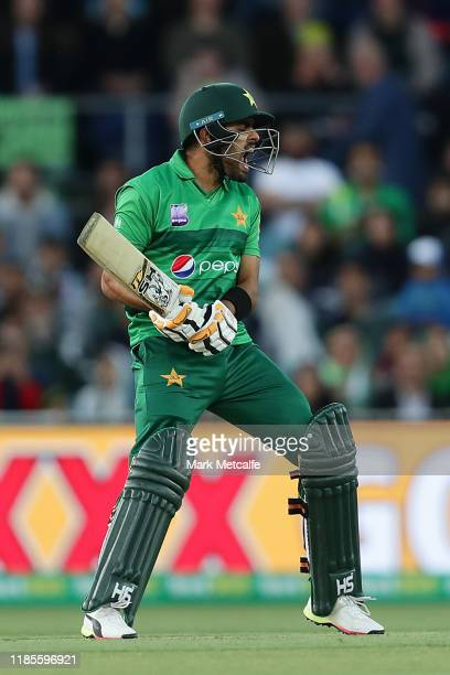 Babar Azam of Pakistan reacts after playing a shot during game two of the International Twenty20 series between Australia and Pakistan at Manuka Oval...