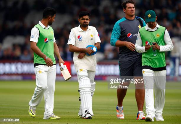 Babar Azam of Pakistan takes a blow to the elbow as he walks off injured during day two of the 1st Test match between England and Pakistan at Lord's...