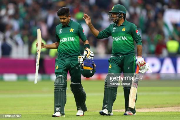 Babar Azam undefeated on 101 runs receives his captain's Sarfaraz Ahmed congratulations after Pakistan's six wicket win during the Group Stage match...