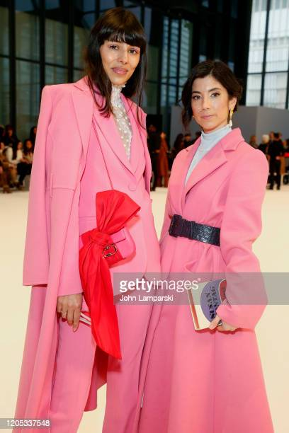 Babba C Rivera and Krystal Bick attend the front row for Carolina Herrera during New York Fashion Week on February 10, 2020 in New York City.
