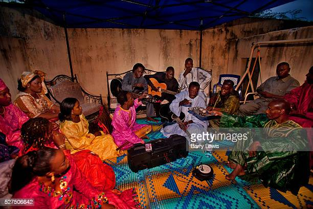 Babba Maal and his musicians in an evening party honouring his friends at his home near Dialaw Senegal Since his father was a fisherman Baaba Maal...
