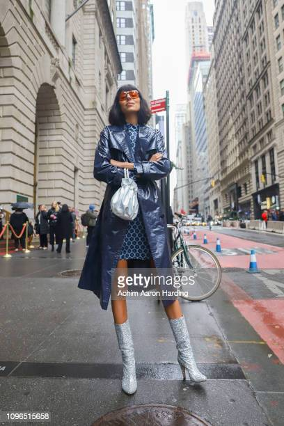 Babba Rivera is seen wearing a blue Kate Spade coat and dress and silver Brother Veilles boots on the street during New York Fashion Week on February...
