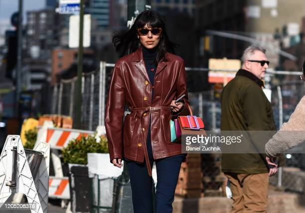 Babba Rivera is seen wearing a maroon leather coat and sunglasses with purse outside the Sies Marjan show during New York Fashion Week: A/W20 on...