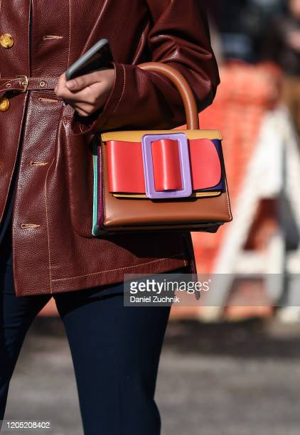 Babba Rivera is seen wearing a maroon leather coat, snakeskin boots and sunglasses with purse outside the Sies Marjan show during New York Fashion...