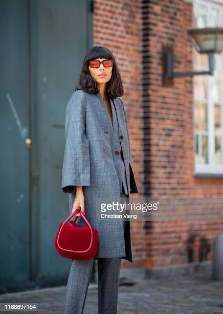 Babba Rivera is seen wearing grey suit outside Rodebjer during Copenhagen Fashion Week Spring/Summer 2020 on August 07, 2019 in Copenhagen, Denmark.