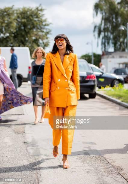 Babba Rivera is seen wearing orange suit outside By Malene Birger during Copenhagen Fashion Week Spring/Summer 2020 on August 08, 2019 in Copenhagen,...